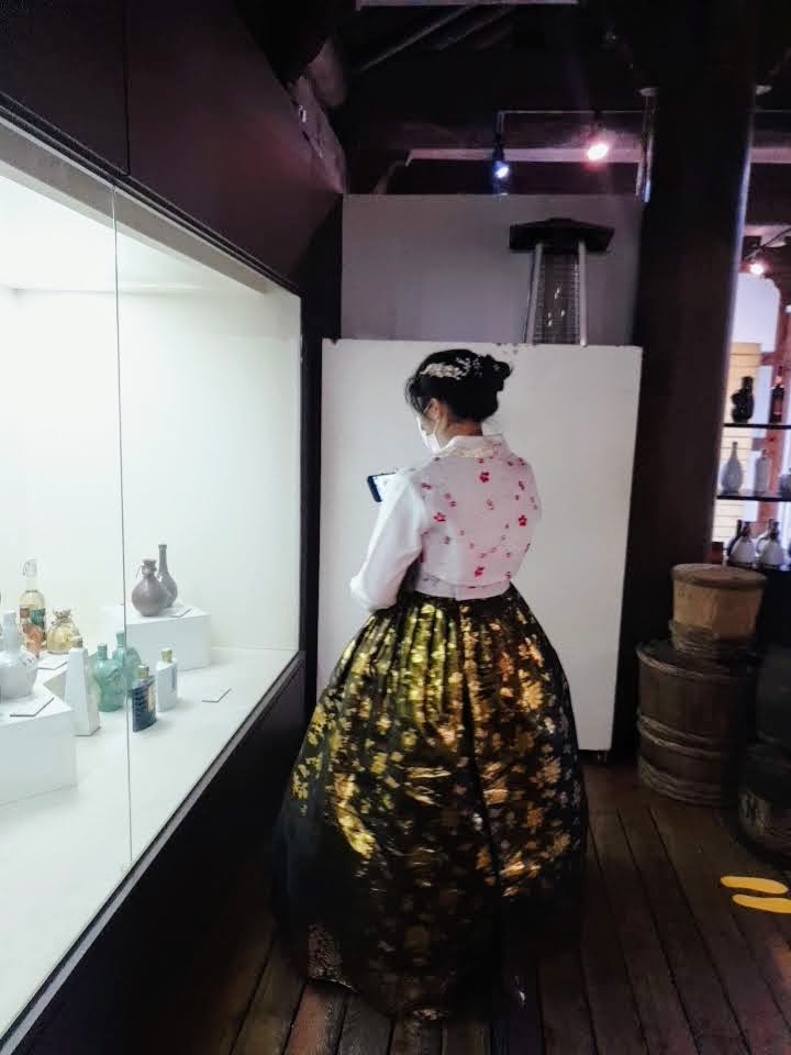 Me in a hanbok, admiring all the pretty jars